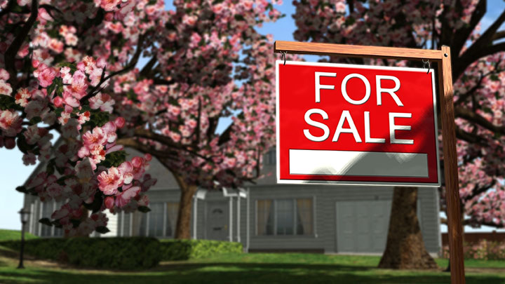 for sale sign in front of real estate for sale